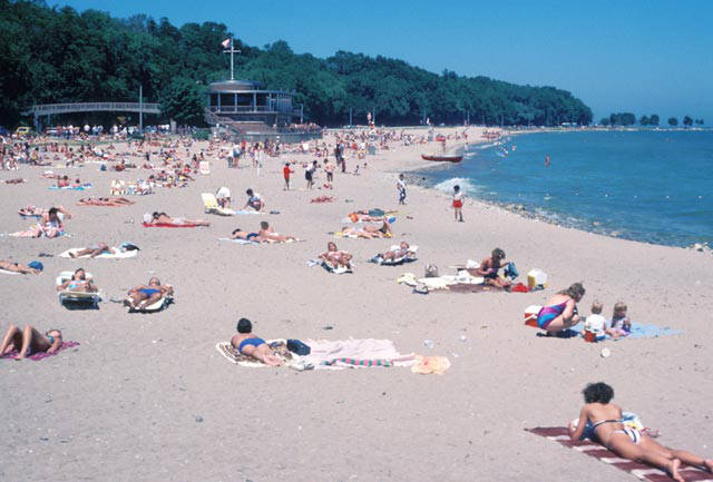 Milwaukee county residents enjoy summer sunshine and sand on Lake Michigan's shoreline in 1985.