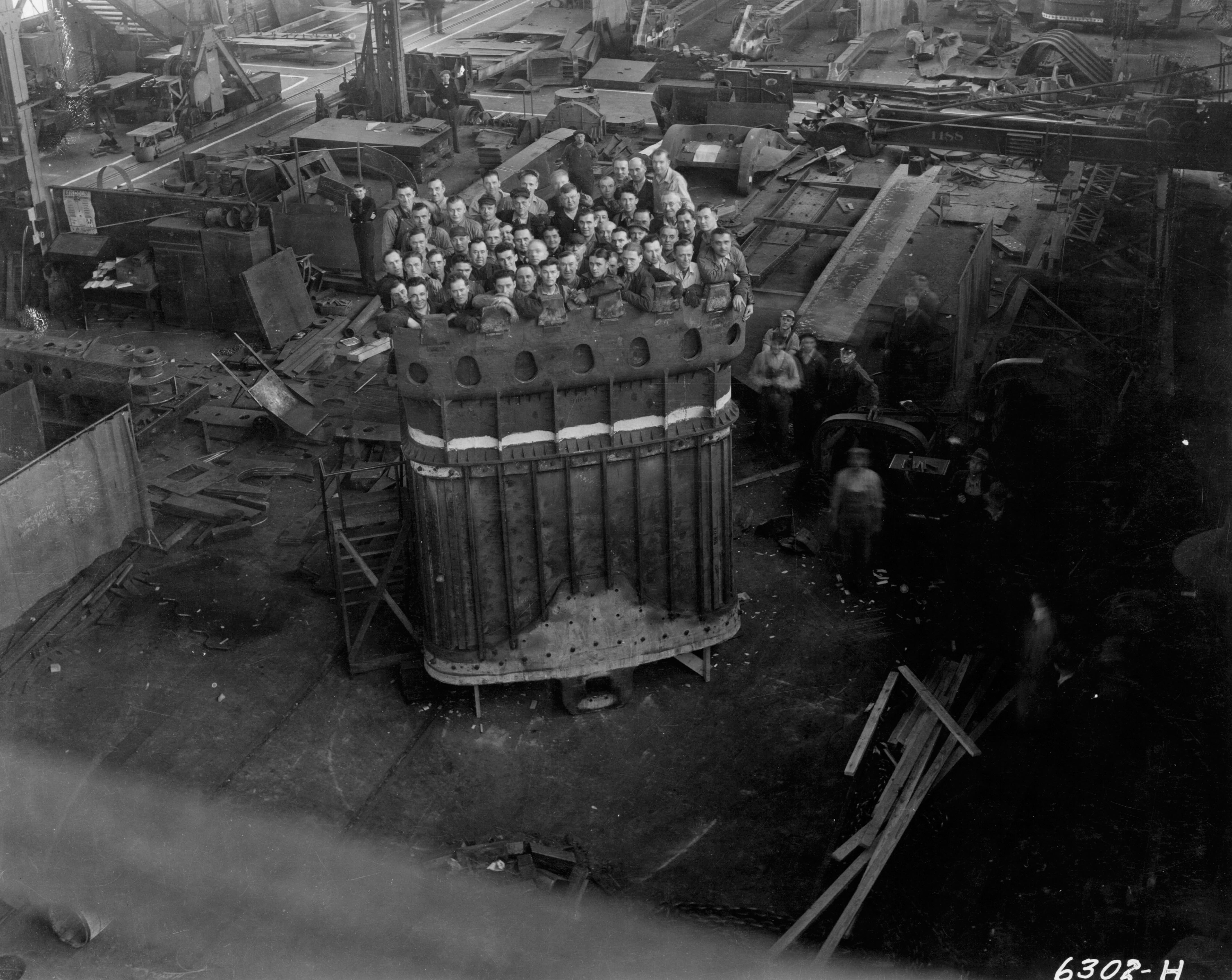 <table class=&quot;lightbox&quot;><tr><td colspan=2 class=&quot;lightbox-title&quot;>Bucyrus International Inc. Employees</td></tr><tr><td colspan=2 class=&quot;lightbox-caption&quot;>52 men stand inside a massive dipper for a 950B stripping shovel manufactured at the Bucyrus-Erie plant in South Milwaukee.</td></tr><tr><td colspan=2 class=&quot;lightbox-spacer&quot;></td></tr><tr class=&quot;lightbox-detail&quot;><td class=&quot;cell-title&quot;>Source: </td><td class=&quot;cell-value&quot;>From the Historic Photo Collection of the Milwaukee Public Library. Reprinted with permission. <br /><a href=&quot;http://content.mpl.org/cdm/singleitem/collection/HstoricPho/id/2418/rec/3&quot; target=&quot;_blank&quot;>Milwaukee Public Library</a></td></tr><tr class=&quot;filler-row&quot;><td colspan=2>&nbsp;</td></tr></table>