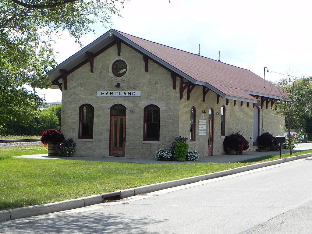 <table class=&quot;lightbox&quot;><tr><td colspan=2 class=&quot;lightbox-title&quot;>Hartland Railroad Depot</td></tr><tr><td colspan=2 class=&quot;lightbox-caption&quot;>The Chicago, Milwaukee, and St. Paul Railroad Depot, built in Hartland in 1879, is the last remaining railroad depot in the Village.</td></tr><tr><td colspan=2 class=&quot;lightbox-spacer&quot;></td></tr><tr class=&quot;lightbox-detail&quot;><td class=&quot;cell-title&quot;>Source: </td><td class=&quot;cell-value&quot;>From the Wikimedia Commons. Photograph by Wikimedia username Shadowe. CC BY-SA 3.0.<br /><a href=&quot;https://en.wikipedia.org/wiki/File:Hartland_Railroad_Depot.JPG&quot; target=&quot;_blank&quot;>Wikimedia Commons</a></td></tr><tr class=&quot;filler-row&quot;><td colspan=2>&nbsp;</td></tr></table>