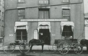 Photograph of a storefront for Layton & Co. Beef and Pork Packers on Water Street in 1888. Founded in 1863 by Frederick Layton, it was one of Milwaukee's most prominent meatpacking companies.