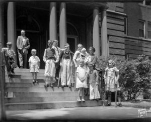Children stand on the steps of the Milwaukee Children's Hospital in June 1936. Several of the children are using crutches.