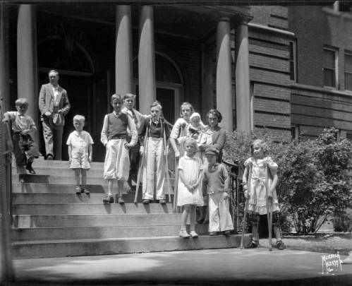 <table class=&quot;lightbox&quot;><tr><td colspan=2 class=&quot;lightbox-title&quot;>On the Steps of Children's Hospital</td></tr><tr><td colspan=2 class=&quot;lightbox-caption&quot;>Children stand on the steps of the Milwaukee Children's Hospital in June 1936. Several of the children are using crutches. </td></tr><tr><td colspan=2 class=&quot;lightbox-spacer&quot;></td></tr><tr class=&quot;lightbox-detail&quot;><td class=&quot;cell-title&quot;>Source: </td><td class=&quot;cell-value&quot;>From the James Blair Murdoch Photographs. Archives, University of Wisconsin-Milwaukee Libraries. <br /><a href=&quot;http://collections.lib.uwm.edu/digital/collection/jbmurdoch/id/880/rec/1&quot; target=&quot;_blank&quot;>University of Wisconsin-Milwaukee Libraries</a></td></tr><tr class=&quot;filler-row&quot;><td colspan=2>&nbsp;</td></tr></table>