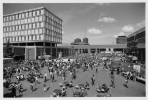 Students gather on UWM's plaza for a party in September 1985. Bolton Hall is on the left, Golda Meir Library center background, and the Fine Arts Center is on the right.