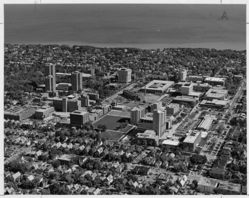 Aerial photograph of UWM's campus taken in 1983. Lake Michigan is visible in the background and surrounding neighborhoods are in the foreground.