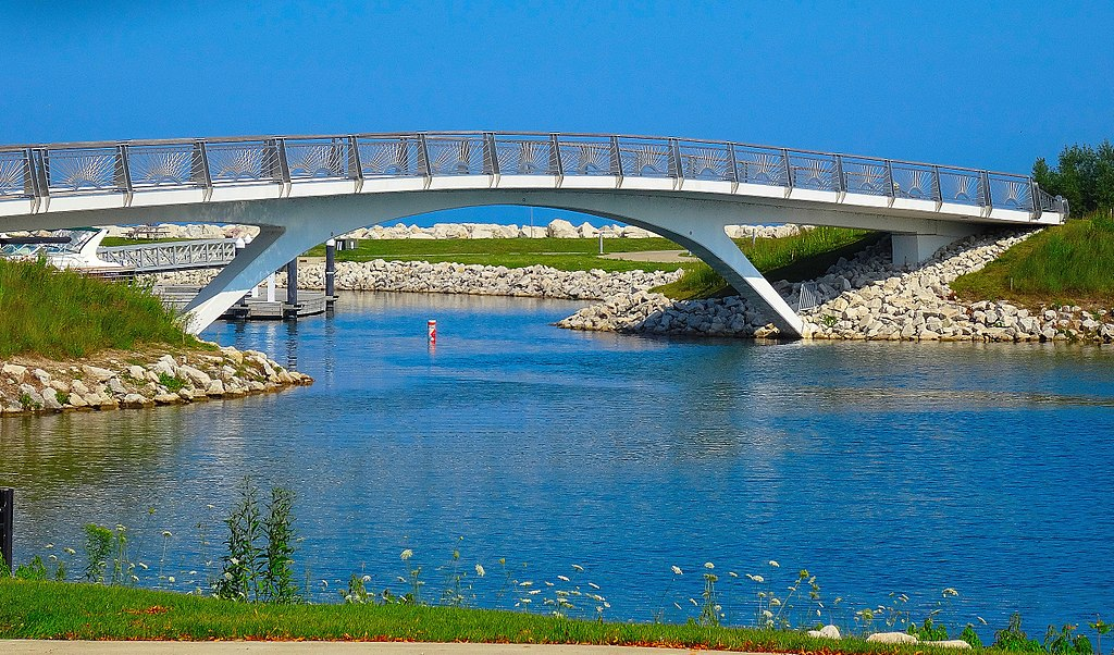 <table class=&quot;lightbox&quot;><tr><td colspan=2 class=&quot;lightbox-title&quot;>Lakeshore Park</td></tr><tr><td colspan=2 class=&quot;lightbox-caption&quot;>Photograph of the Lakeshore Park Bridge on a bright summer day in 2015. </td></tr><tr><td colspan=2 class=&quot;lightbox-spacer&quot;></td></tr><tr class=&quot;lightbox-detail&quot;><td class=&quot;cell-title&quot;>Source: </td><td class=&quot;cell-value&quot;>From the Wikimedia Commons. Photograph by Corey Coyle. CC BY 3.0.<br /><a href=&quot;https://commons.wikimedia.org/wiki/File:Lakeshore_State_Park_Bridge_-_panoramio_(1).jpg&quot; target=&quot;_blank&quot;>Wikimedia Commons</a></td></tr><tr class=&quot;filler-row&quot;><td colspan=2>&nbsp;</td></tr></table>