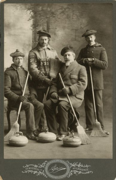 Photograph of a 19th century curling team from Milwaukee. Seated second from the right is John Johnston, a successful banker, member of the Milwaukee Curling Club, and president of the Grand National Curling Club of American from 1877-1879.