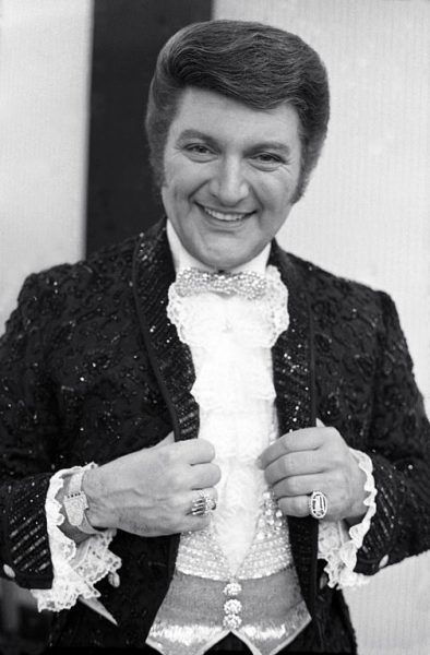 Liberace poses for a photograph in 1968.