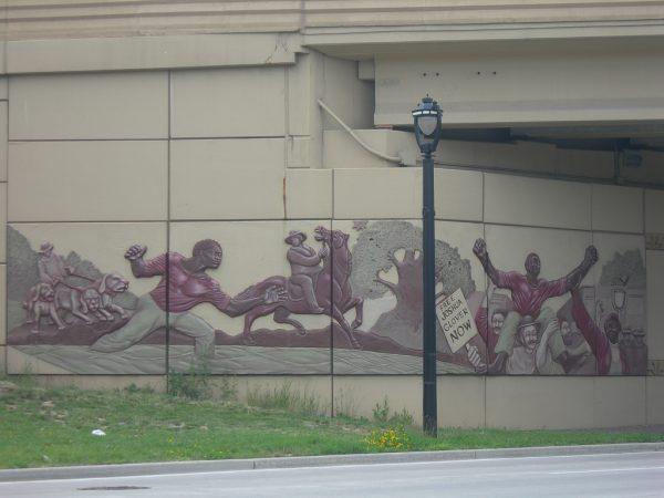 Found on the I-43 overpass in Milwaukee, this mural depicts Joshua Glover's escape from slavery.