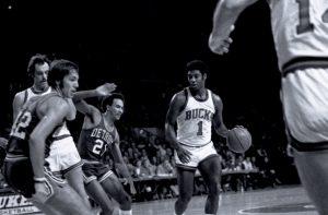 Oscar Robertson, star Bucks point card from 1970-1974, dribbles the ball against the Detroit Pistons.