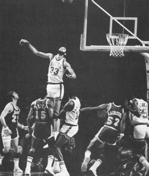 A member of the Milwaukee Bucks from 1969-1975, six-time MVP center Kareem Abdul-Jabbar jumps for the basketball.