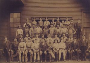 39 employees pose for a photograph at the Bay View Rolling Mill. This photo was taken in 1886, the year of the large and deadly workers' strike.