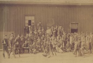 A group of armed militia men called to oppose the 1886 workers' strike pose for a photograph.