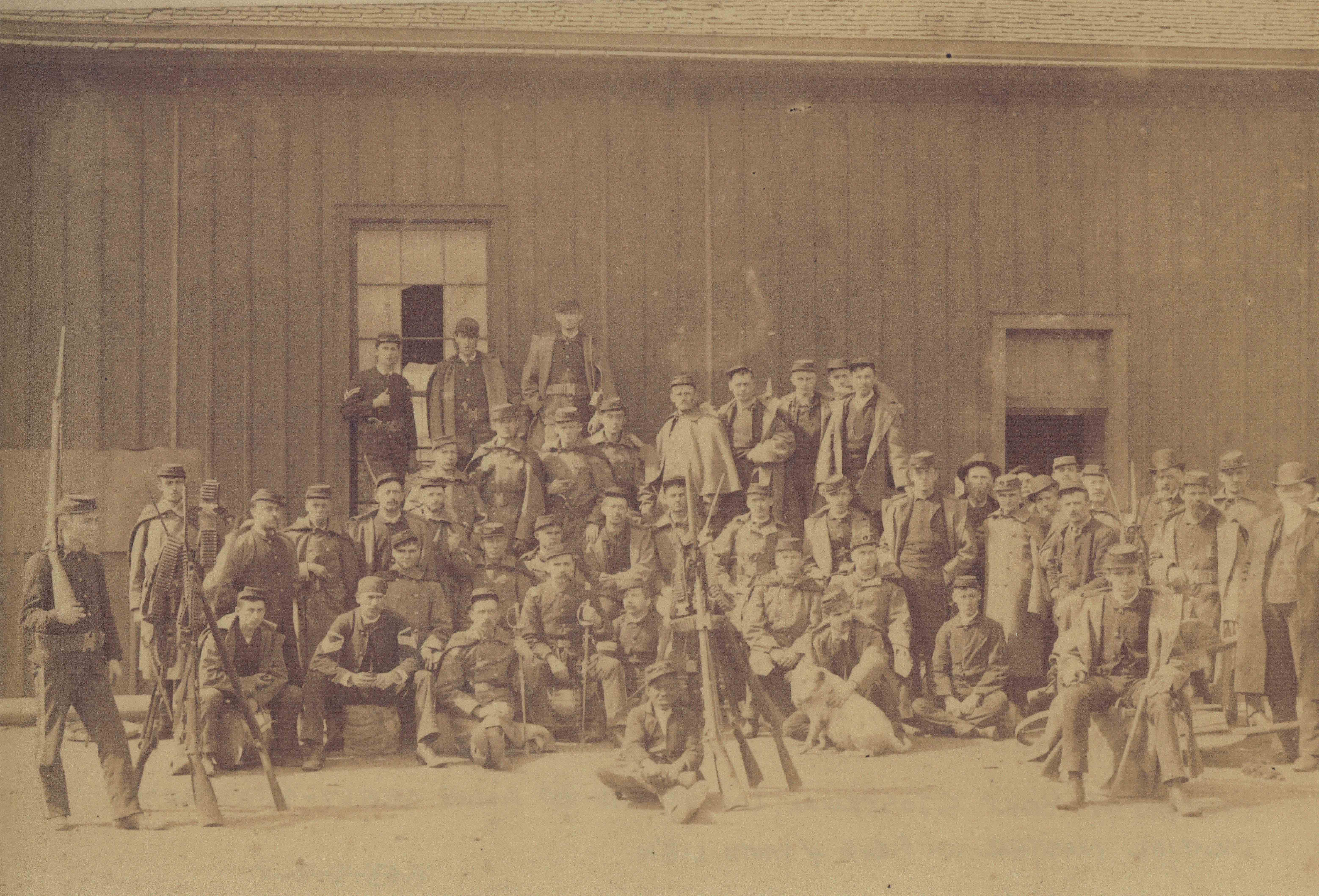 <table class=&quot;lightbox&quot;><tr><td colspan=2 class=&quot;lightbox-title&quot;>Rolling Mill Strike Militia</td></tr><tr><td colspan=2 class=&quot;lightbox-caption&quot;>A group of armed militia men called to oppose the 1886 workers' strike pose for a photograph. </td></tr><tr><td colspan=2 class=&quot;lightbox-spacer&quot;></td></tr><tr class=&quot;lightbox-detail&quot;><td class=&quot;cell-title&quot;>Source: </td><td class=&quot;cell-value&quot;>From the Historic Photo Collection of the Milwaukee Public Library. Reprinted with permission. <br /><a href=&quot;http://content.mpl.org/cdm/singleitem/collection/HstoricPho/id/2681/rec/19&quot; target=&quot;_blank&quot;>Milwaukee Public Library</a></td></tr><tr class=&quot;filler-row&quot;><td colspan=2>&nbsp;</td></tr></table>