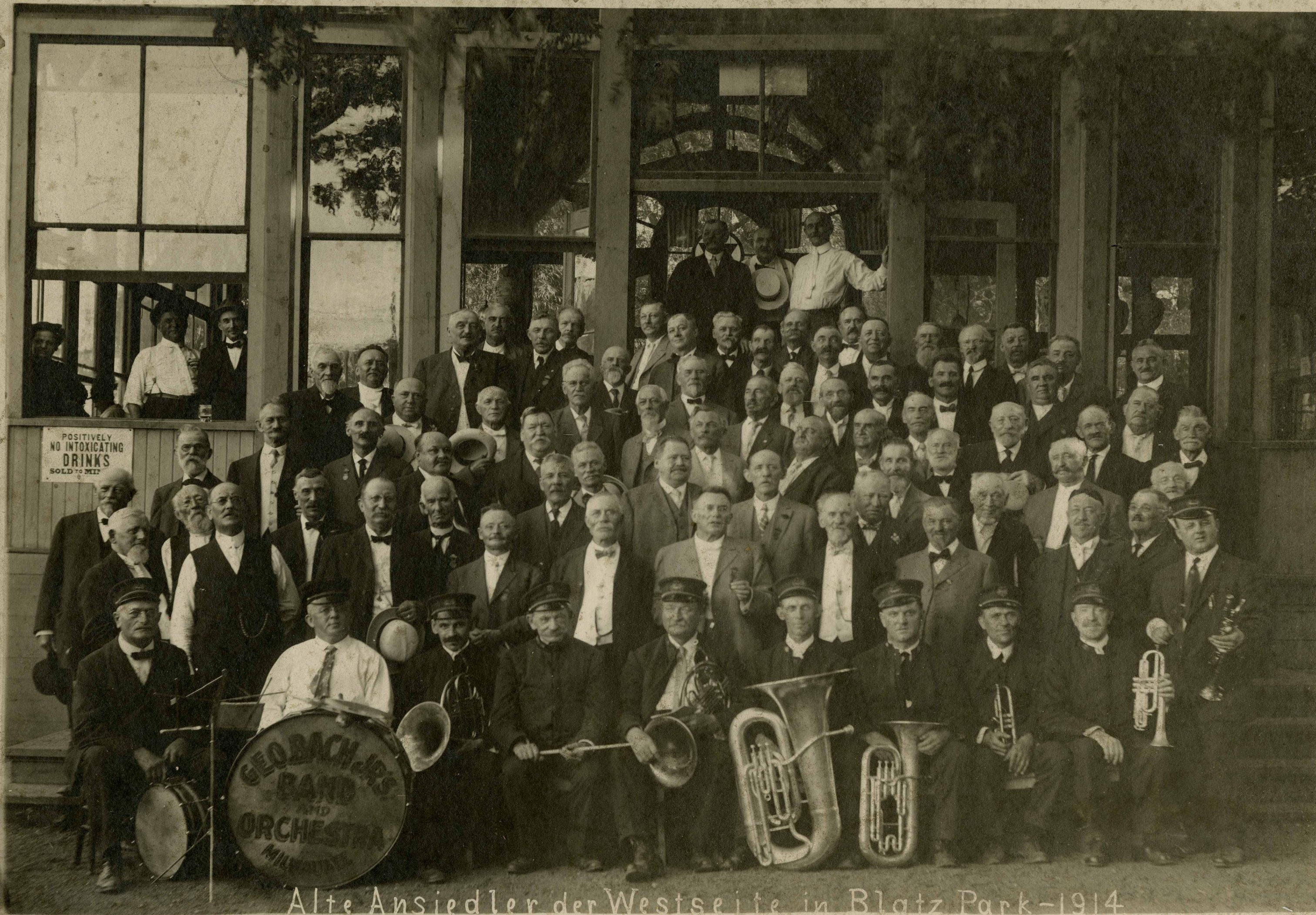 Photograph of a German community band and orchestra in Blatz Park in 1914.