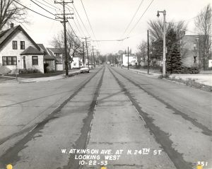 A view of Atkinson Avenue in 1953. The old streetcar rail lines have recently been paved over, but the overhead wires are still visible.