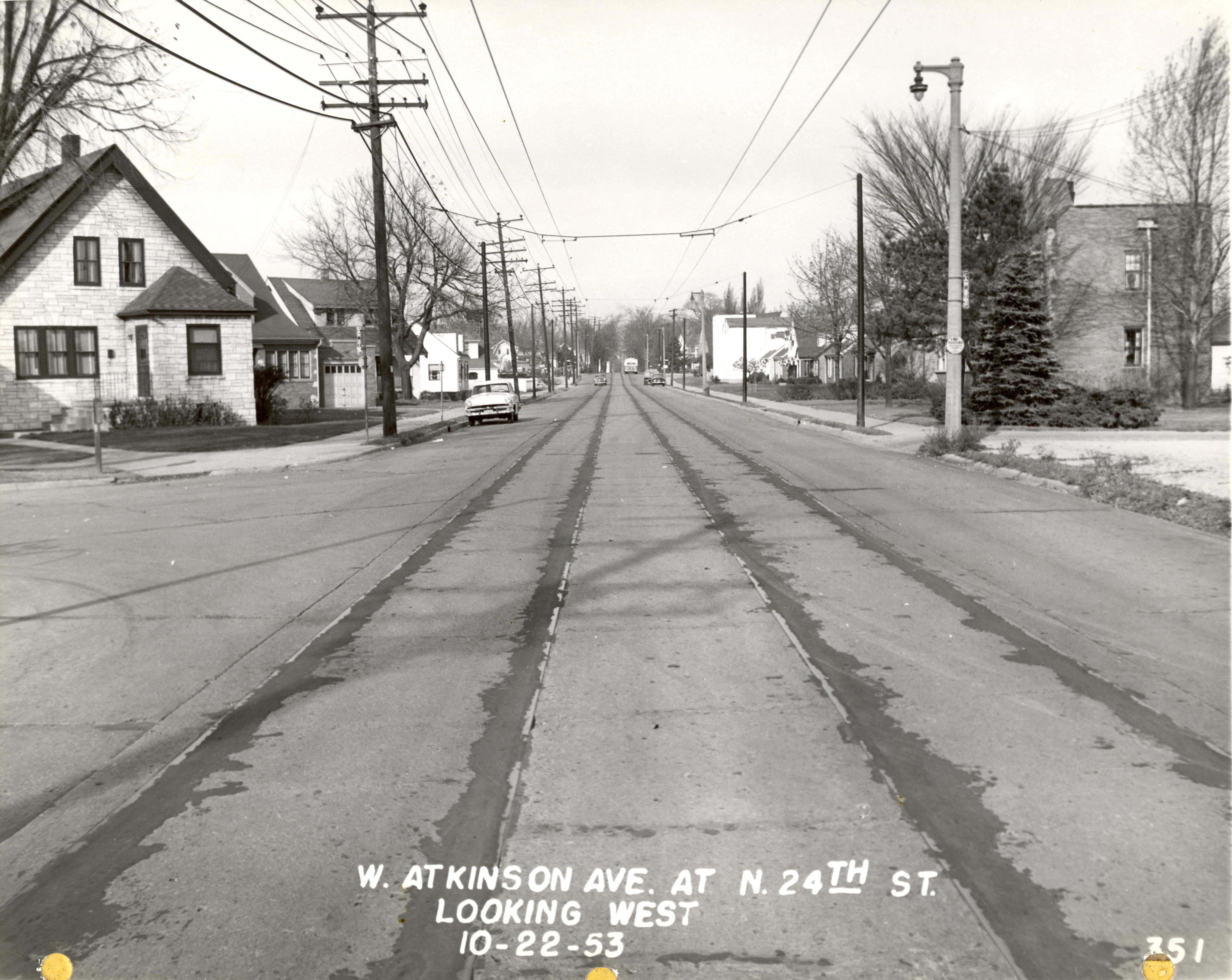 <table class=&quot;lightbox&quot;><tr><td colspan=2 class=&quot;lightbox-title&quot;>Looking Down Atkinson Avenue</td></tr><tr><td colspan=2 class=&quot;lightbox-caption&quot;>A view of Atkinson Avenue in 1953. The old streetcar rail lines have recently been paved over, but the overhead wires are still visible. </td></tr><tr><td colspan=2 class=&quot;lightbox-spacer&quot;></td></tr><tr class=&quot;lightbox-detail&quot;><td class=&quot;cell-title&quot;>Source: </td><td class=&quot;cell-value&quot;>From the Historic Photo Collection of the Milwaukee Public Library. Reprinted with permission. <br /><a href=&quot;http://content.mpl.org/cdm/singleitem/collection/HstoricPho/id/918/rec/84&quot; target=&quot;_blank&quot;>Milwaukee Public Library</a></td></tr><tr class=&quot;filler-row&quot;><td colspan=2>&nbsp;</td></tr></table>
