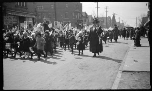 Children accompanied by women march down Lincoln Avenue on April 1, 1918 during a liberty loan parade.