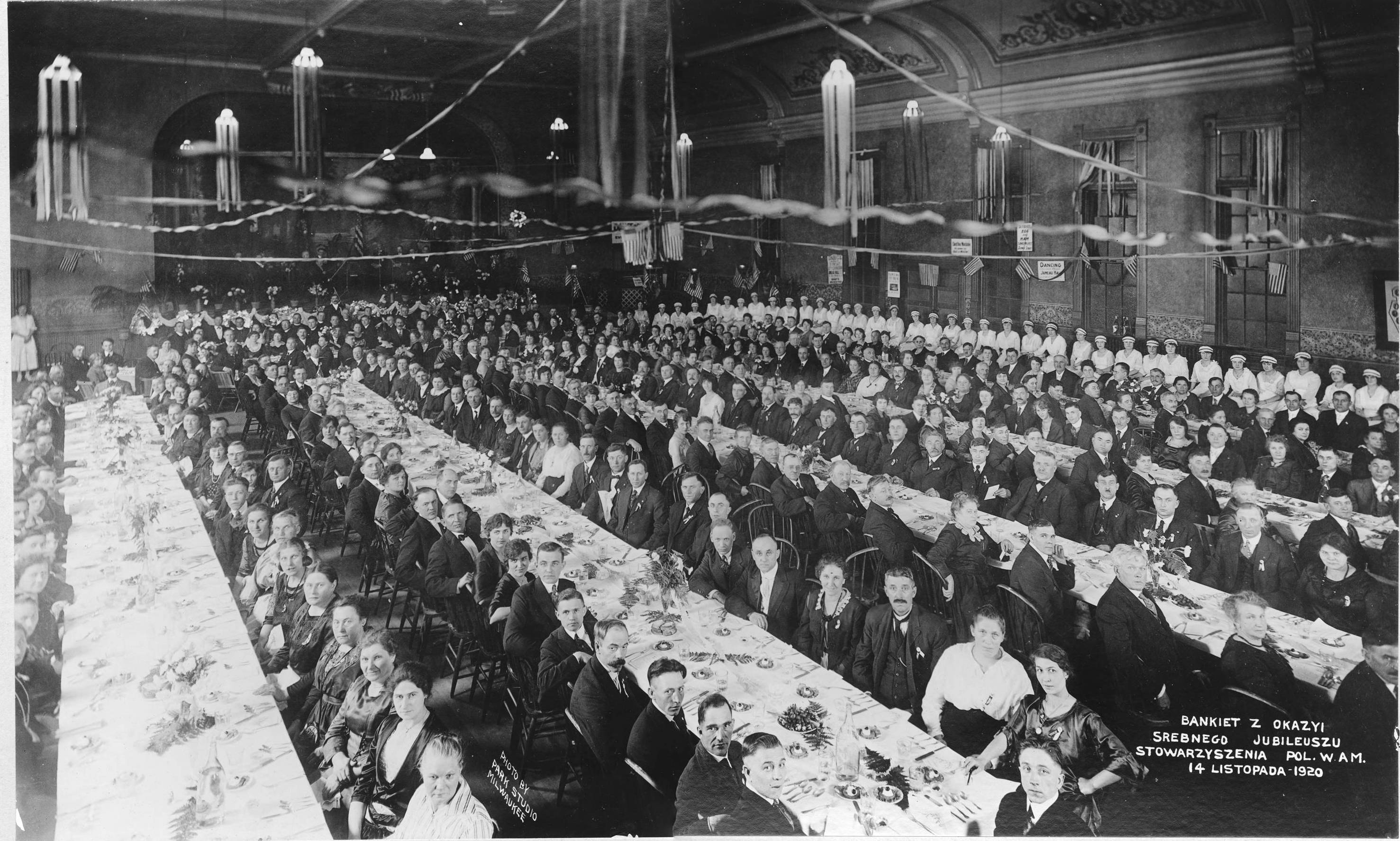 <table class=&quot;lightbox&quot;><tr><td colspan=2 class=&quot;lightbox-title&quot;>Association of Poles in America Banquet</td></tr><tr><td colspan=2 class=&quot;lightbox-caption&quot;>1920 photograph of attendees at the Silver Jubilee Banquet of the Association of Poles in America Banquet.</td></tr><tr><td colspan=2 class=&quot;lightbox-spacer&quot;></td></tr><tr class=&quot;lightbox-detail&quot;><td class=&quot;cell-title&quot;>Source: </td><td class=&quot;cell-value&quot;>From the Roman B. Kwaniewski Photographs Collection, Archives. University of Wisconsin-Milwaukee Libraries. </td></tr><tr class=&quot;filler-row&quot;><td colspan=2>&nbsp;</td></tr></table>