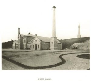 The North Point Water Works, shown around 1885, including the standpipe at the top of the hill on the right.