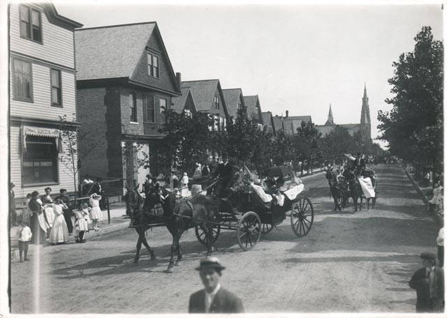 <table class=&quot;lightbox&quot;><tr><td colspan=2 class=&quot;lightbox-title&quot;>Riverwest Parade</td></tr><tr><td colspan=2 class=&quot;lightbox-caption&quot;>Carriages parade past Frank Burczyk Saloon on North Bremen Street in Riverwest.</td></tr><tr><td colspan=2 class=&quot;lightbox-spacer&quot;></td></tr><tr class=&quot;lightbox-detail&quot;><td class=&quot;cell-title&quot;>Source: </td><td class=&quot;cell-value&quot;>From the Milwaukee Neighborhoods: Photos and Maps 1885-1992 Collection, Archives. University of Wisconsin-Milwaukee Libraries.<br /><a href=&quot;https://collections.lib.uwm.edu/digital/collection/mkenh/id/400/rec/1&quot; target=&quot;_blank&quot;>University of Wisconsin-Milwaukee Libraries</a></td></tr><tr class=&quot;filler-row&quot;><td colspan=2>&nbsp;</td></tr></table>