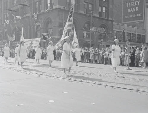 <table class=&quot;lightbox&quot;><tr><td colspan=2 class=&quot;lightbox-title&quot;>World War Two Victory Parade</td></tr><tr><td colspan=2 class=&quot;lightbox-caption&quot;>Members of the Milwaukee Elk's Lodge Red Cross Unit parade down Wisconsin Avenue on August 15, 1945 to celebrate V-J Day, marking the Allied victory over Imperial Japan.</td></tr><tr><td colspan=2 class=&quot;lightbox-spacer&quot;></td></tr><tr class=&quot;lightbox-detail&quot;><td class=&quot;cell-title&quot;>Source: </td><td class=&quot;cell-value&quot;>From the Milwaukee Neighborhoods: Photos and Maps 1885-1992 Collection, Archives. University of Wisconsin-Milwaukee Libraries.</td></tr><tr class=&quot;filler-row&quot;><td colspan=2>&nbsp;</td></tr></table>