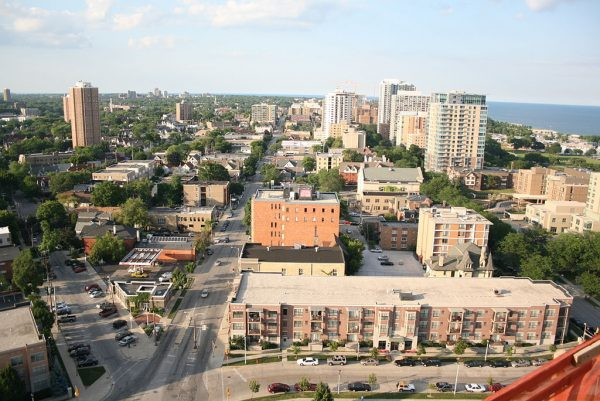 This 2008 photograph shows a portion of Milwaukee's East Side, looking north along Farwell Avenue. Highrise private housing is visible along the lakefront, and a public highrise tower stands on the left side of the image.