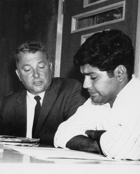 John W. Schmitt (left) meets with Jesus Salas (right), leader of Wisconsin's migrant farm worker union, Obreros Unidos, in 1967.
