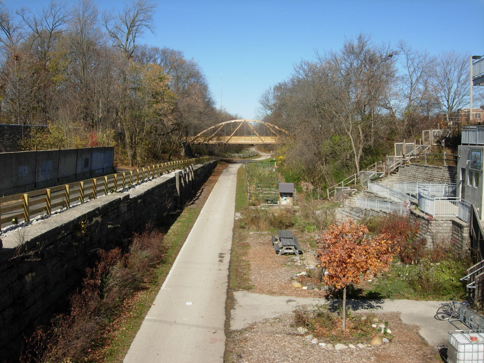 <table class=&quot;lightbox&quot;><tr><td colspan=2 class=&quot;lightbox-title&quot;>Oak Leaf Trail</td></tr><tr><td colspan=2 class=&quot;lightbox-caption&quot;>A view of the Oak Leaf Trail running just west of the Urban Ecology Center, with the East Park Place Bridge in the distance.</td></tr><tr><td colspan=2 class=&quot;lightbox-spacer&quot;></td></tr><tr class=&quot;lightbox-detail&quot;><td class=&quot;cell-title&quot;>Source: </td><td class=&quot;cell-value&quot;>From Flickr. Photograph by Aaron Volkening. CC BY 2.0.<br /><a href=&quot;https://www.flickr.com/photos/87297882@N03/14602970857/&quot; target=&quot;_blank&quot;>Flickr</a></td></tr><tr class=&quot;filler-row&quot;><td colspan=2>&nbsp;</td></tr></table>