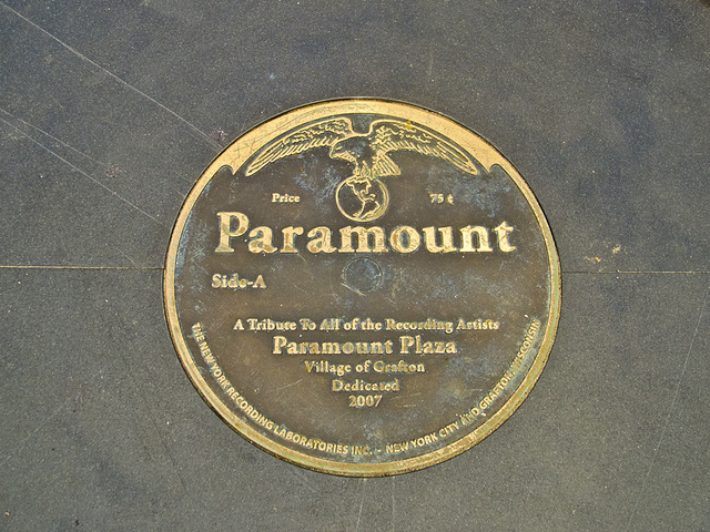 <table class=&quot;lightbox&quot;><tr><td colspan=2 class=&quot;lightbox-title&quot;>Paramount Plaza Plaque</td></tr><tr><td colspan=2 class=&quot;lightbox-caption&quot;>A plaque in Grafton's Paramount Plaza.</td></tr><tr><td colspan=2 class=&quot;lightbox-spacer&quot;></td></tr><tr class=&quot;lightbox-detail&quot;><td class=&quot;cell-title&quot;>Source: </td><td class=&quot;cell-value&quot;>From Flickr. Photograph by Kenneth Casper. CC BY 2.0.<br /><a href=&quot;https://www.flickr.com/photos/kfcasper/14709072603/&quot; target=&quot;_blank&quot;>Flickr</a></td></tr><tr class=&quot;filler-row&quot;><td colspan=2>&nbsp;</td></tr></table>