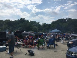 Groups of people barbecue and relax behind their cars before a Brewer game in 2016.