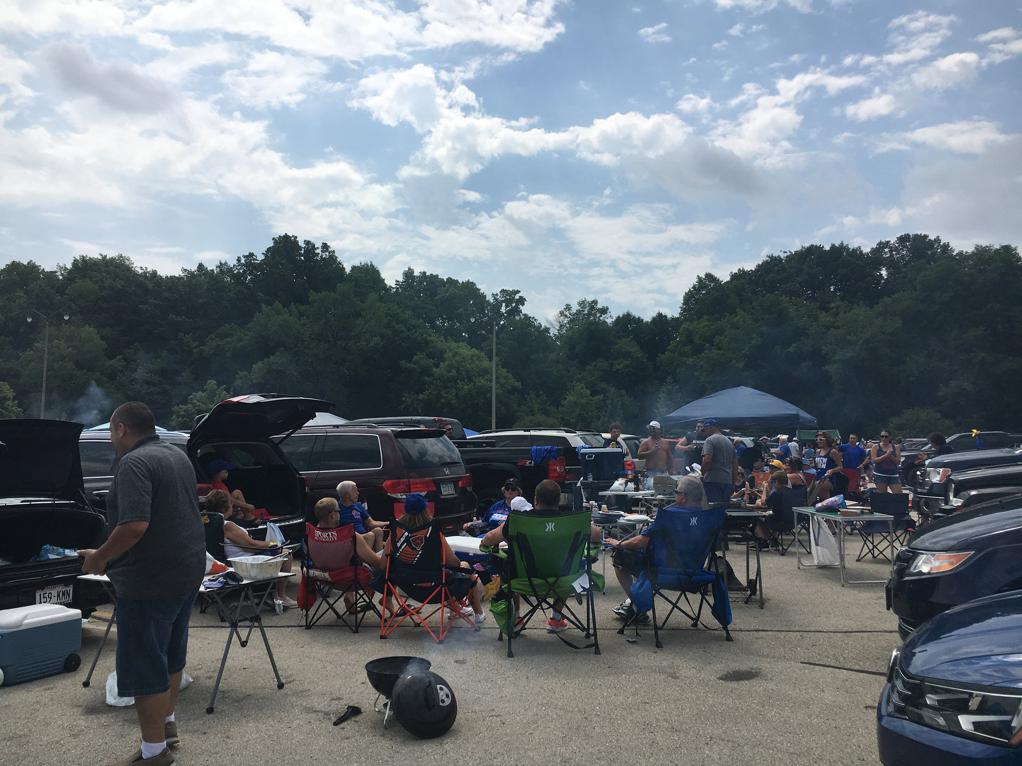 <table class=&quot;lightbox&quot;><tr><td colspan=2 class=&quot;lightbox-title&quot;>Miller Park Tailgating</td></tr><tr><td colspan=2 class=&quot;lightbox-caption&quot;>Groups of people barbecue and relax behind their cars before a Brewer game in 2016.</td></tr><tr><td colspan=2 class=&quot;lightbox-spacer&quot;></td></tr><tr class=&quot;lightbox-detail&quot;><td class=&quot;cell-title&quot;>Source: </td><td class=&quot;cell-value&quot;>From Flickr. Photograph by Julie Corsi. CC BY 2.0.<br /><a href=&quot;https://www.flickr.com/photos/corsinet/28243447550/&quot; target=&quot;_blank&quot;>Flickr</a></td></tr><tr class=&quot;filler-row&quot;><td colspan=2>&nbsp;</td></tr></table>