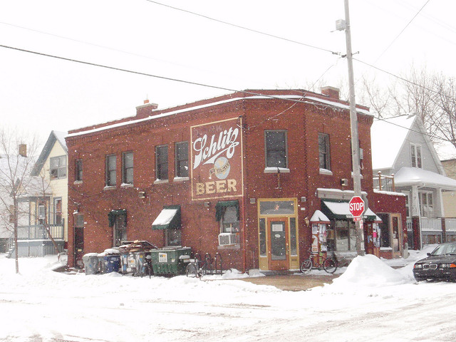 <table class=&quot;lightbox&quot;><tr><td colspan=2 class=&quot;lightbox-title&quot;>Riverwest Co-Op</td></tr><tr><td colspan=2 class=&quot;lightbox-caption&quot;>Snowy photograph of the exterior of the Riverwest Co-Op, which acts as both a grocery store and cafe for neighborhood residents.</td></tr><tr><td colspan=2 class=&quot;lightbox-spacer&quot;></td></tr><tr class=&quot;lightbox-detail&quot;><td class=&quot;cell-title&quot;>Source: </td><td class=&quot;cell-value&quot;>From Flickr. Photograph by Darius Norvilas. CC BY-NC 2.0.<br /><a href=&quot;https://www.flickr.com/photos/istorija/3326791503/&quot; target=&quot;_blank&quot;>Flickr</a></td></tr><tr class=&quot;filler-row&quot;><td colspan=2>&nbsp;</td></tr></table>