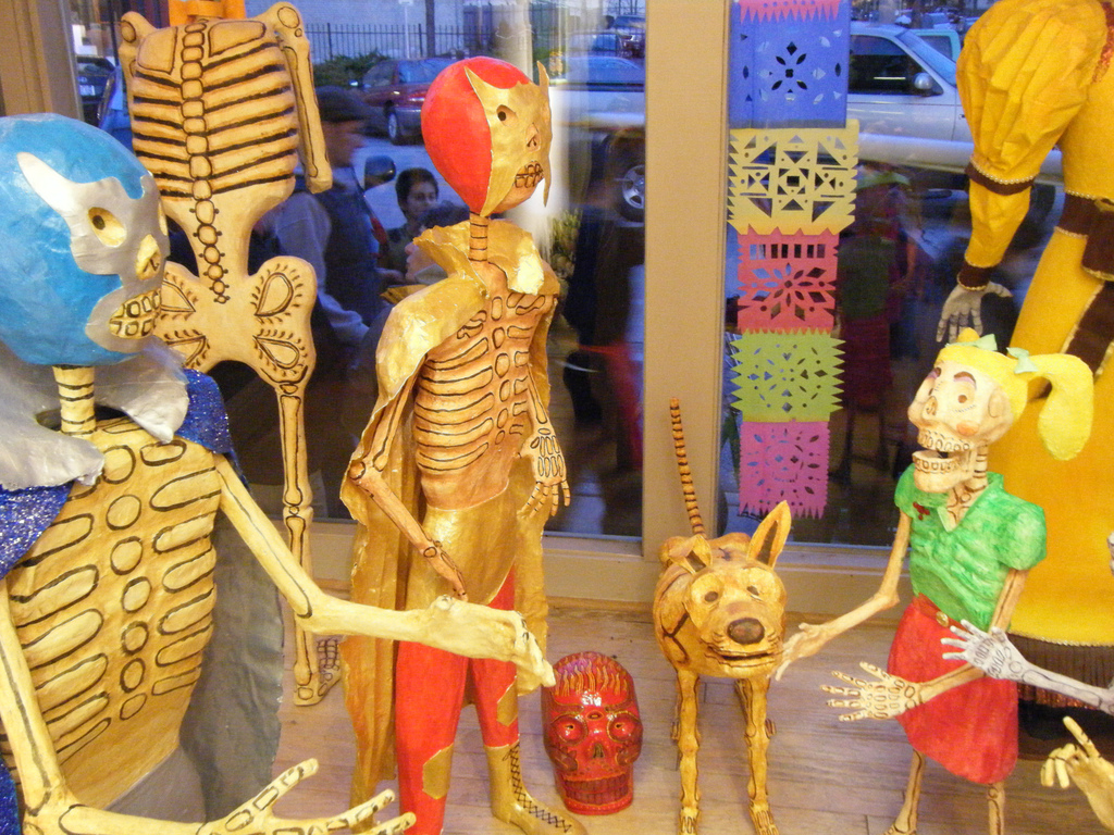 <table class=&quot;lightbox&quot;><tr><td colspan=2 class=&quot;lightbox-title&quot;>WPCA Dia de Los Muertos Display</td></tr><tr><td colspan=2 class=&quot;lightbox-caption&quot;>The Walker's Point Center for the Arts features a large celebration for Dia de Los Muertos every year. </td></tr><tr><td colspan=2 class=&quot;lightbox-spacer&quot;></td></tr><tr class=&quot;lightbox-detail&quot;><td class=&quot;cell-title&quot;>Source: </td><td class=&quot;cell-value&quot;>From Flickr. Photograph by Daniel Baker. CC BY-ND 2.0.</td></tr><tr class=&quot;filler-row&quot;><td colspan=2>&nbsp;</td></tr></table>