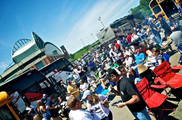 A crowd of people gather between buses to tailgate prior to a Brewer game in 2011.