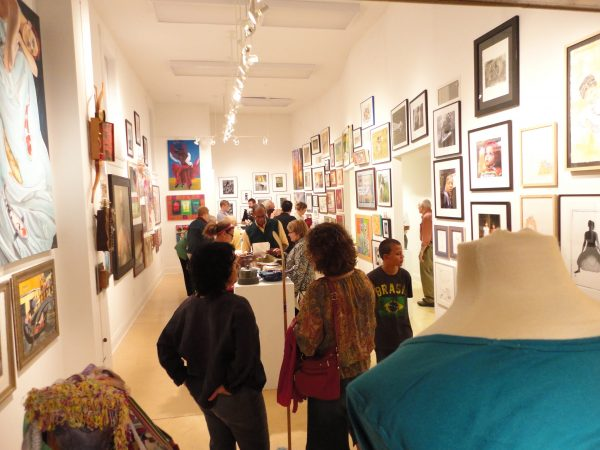 Visitors browse an art show opening at the Walker's Point Center for the Arts in 2011.