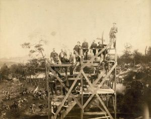 With the Atlanta Cyclorama behind them, a group of German panorama artists stand on scaffolding in their Milwaukee studio in 1886.