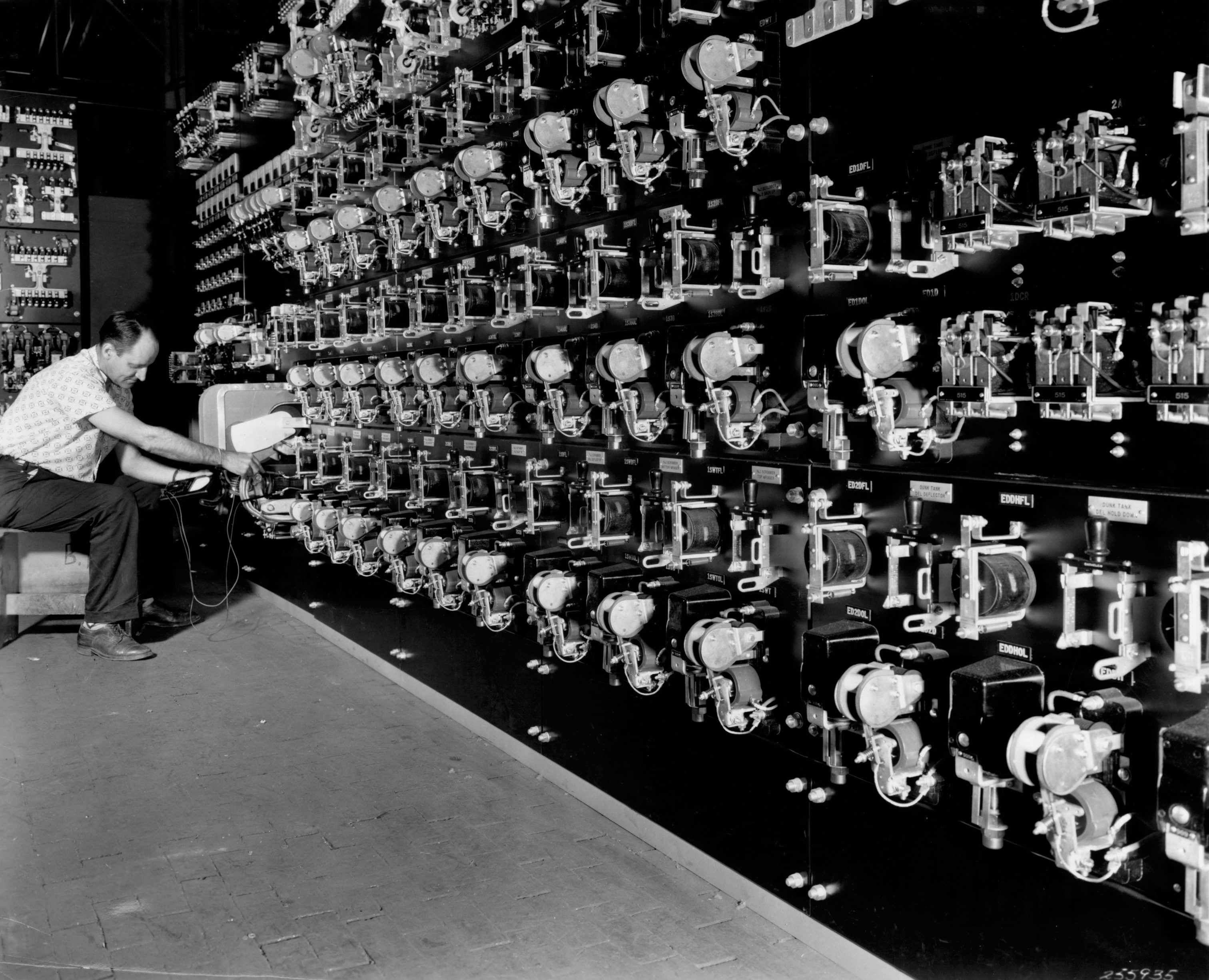 A Cutler-Hammer employee tests electrical controls in 1963.
