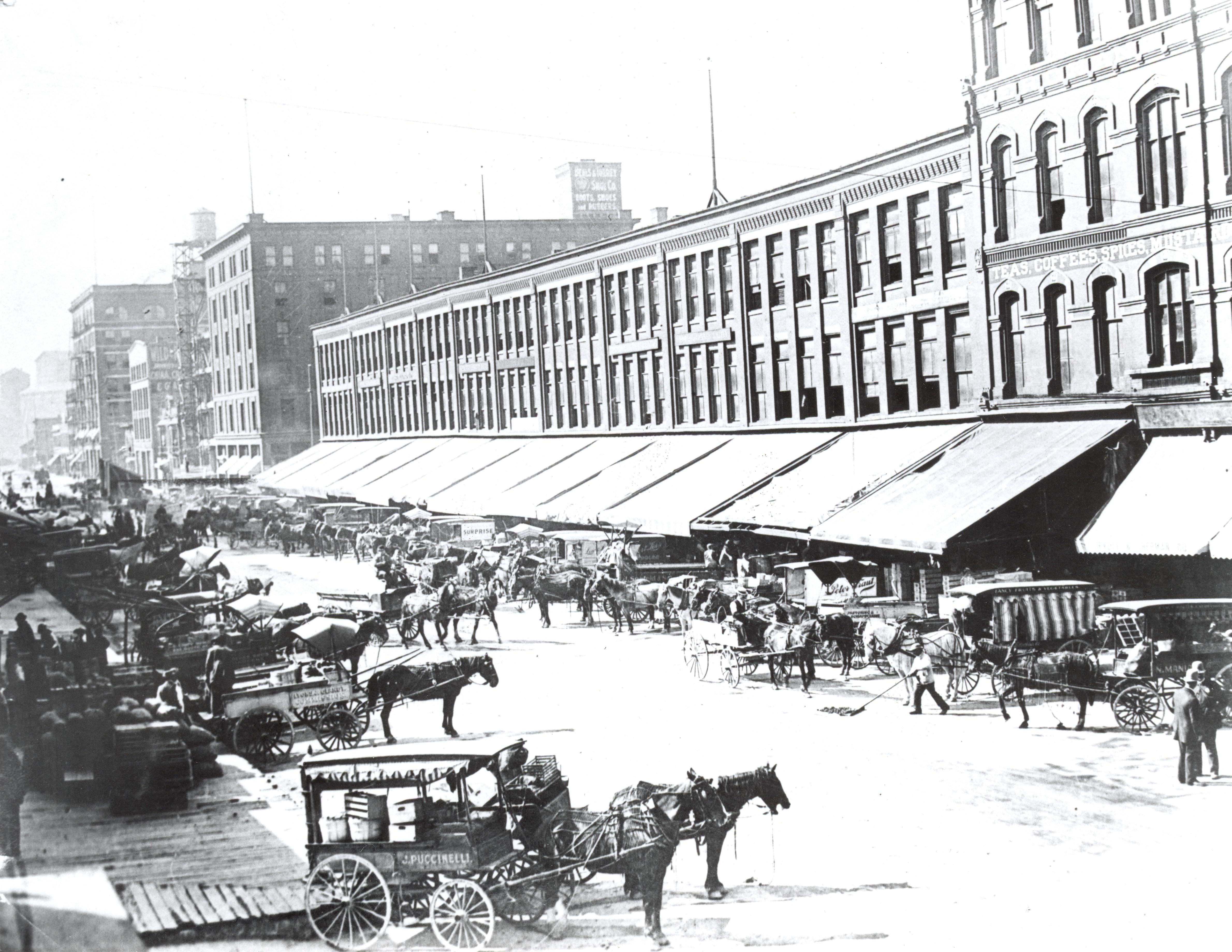 <table class=&quot;lightbox&quot;><tr><td colspan=2 class=&quot;lightbox-title&quot;>Commission Row in Milwaukee</td></tr><tr><td colspan=2 class=&quot;lightbox-caption&quot;>Horse-drawn carts full of produce line Commission Row on Broadway Street. </td></tr><tr><td colspan=2 class=&quot;lightbox-spacer&quot;></td></tr><tr class=&quot;lightbox-detail&quot;><td class=&quot;cell-title&quot;>Source: </td><td class=&quot;cell-value&quot;>From the Historic Photo Collection of the Milwaukee Public Library. Reprinted with permission. <br /><a href=&quot;http://content.mpl.org/cdm/singleitem/collection/HstoricPho/id/1185/rec/1&quot; target=&quot;_blank&quot;>Milwaukee Public Library</a></td></tr><tr class=&quot;filler-row&quot;><td colspan=2>&nbsp;</td></tr></table>