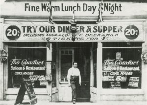 Exterior view of Mader's Restaurant, located on Third Street. Its windows advertise meal specials.
