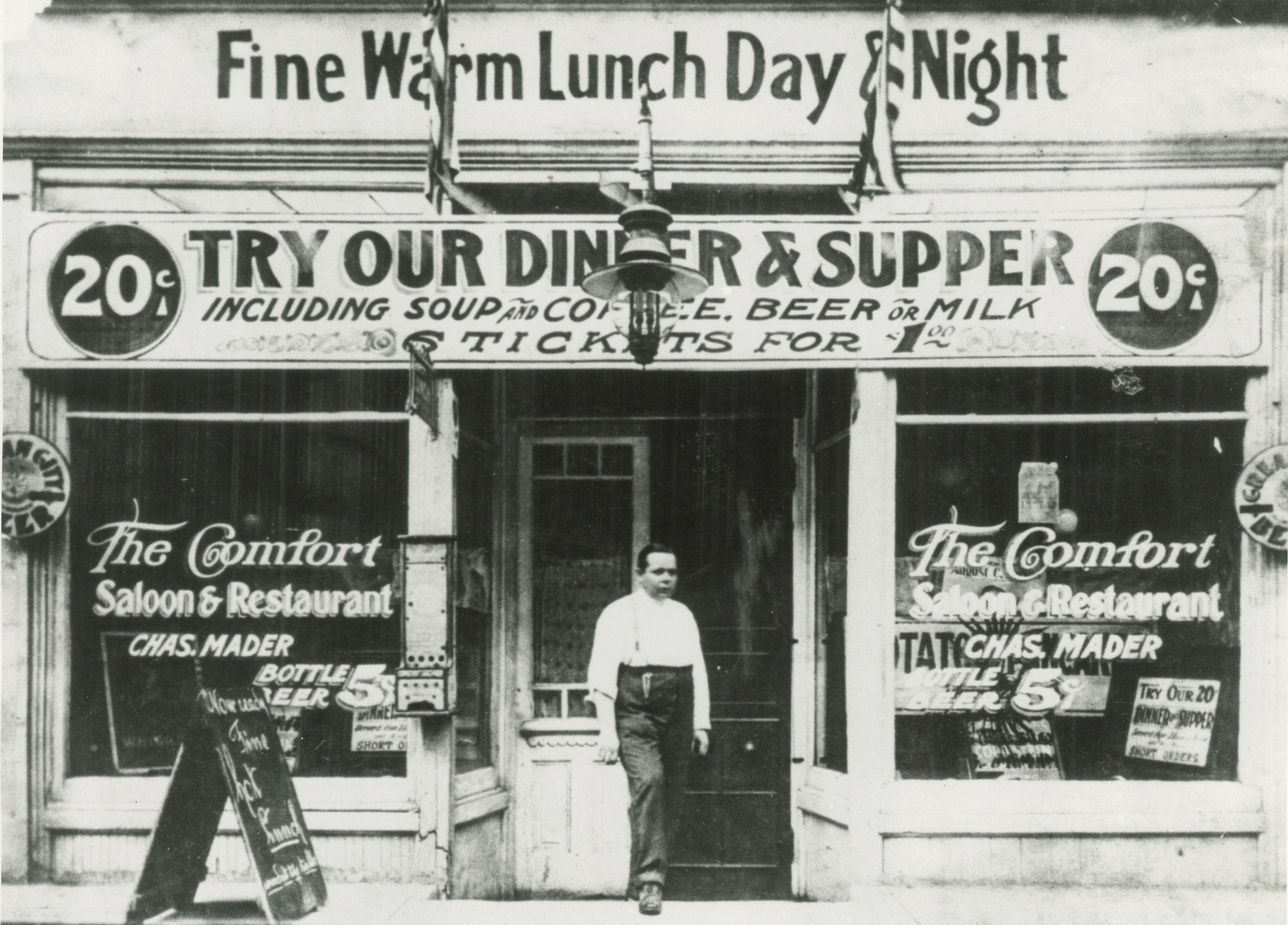 <table class=&quot;lightbox&quot;><tr><td colspan=2 class=&quot;lightbox-title&quot;>Mader's Restaurant</td></tr><tr><td colspan=2 class=&quot;lightbox-caption&quot;>Exterior view of Mader's Restaurant, located on Third Street. Its windows advertise meal specials.</td></tr><tr><td colspan=2 class=&quot;lightbox-spacer&quot;></td></tr><tr class=&quot;lightbox-detail&quot;><td class=&quot;cell-title&quot;>Source: </td><td class=&quot;cell-value&quot;>From the Historic Photo Collection of the Milwaukee Public Library. Reprinted with permission.<br /><a href=&quot;http://content.mpl.org/cdm/singleitem/collection/HstoricPho/id/3656/rec/3&quot; target=&quot;_blank&quot;>Milwaukee Public Library</a></td></tr><tr class=&quot;filler-row&quot;><td colspan=2>&nbsp;</td></tr></table>