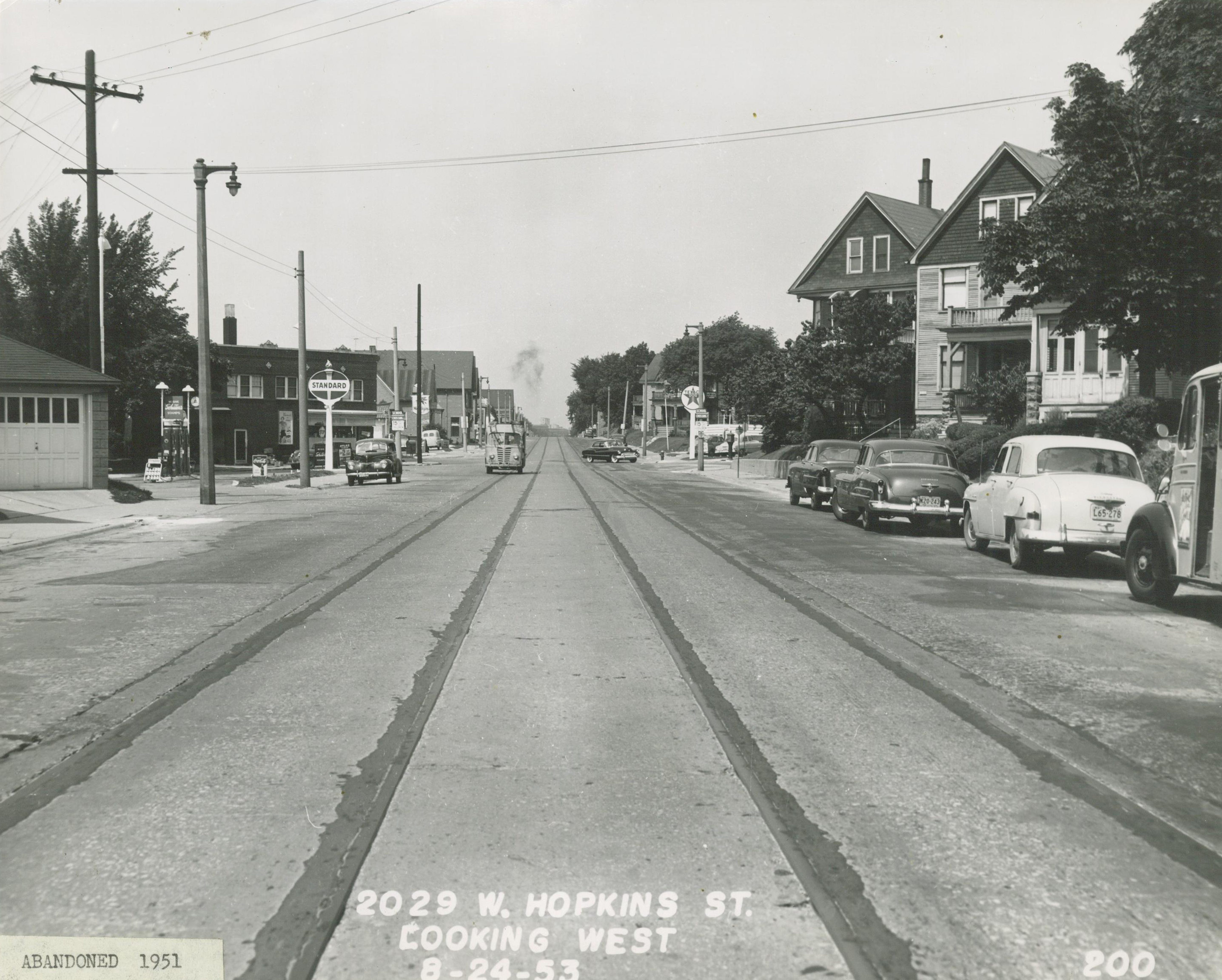 <table class=&quot;lightbox&quot;><tr><td colspan=2 class=&quot;lightbox-title&quot;>Franklin Heights Neighborhood</td></tr><tr><td colspan=2 class=&quot;lightbox-caption&quot;>This westward view of the 2000 block of Hopkins Street shows automobiles, houses, two gas stations, and trolley tracks in 1953.</td></tr><tr><td colspan=2 class=&quot;lightbox-spacer&quot;></td></tr><tr class=&quot;lightbox-detail&quot;><td class=&quot;cell-title&quot;>Source: </td><td class=&quot;cell-value&quot;>From the Historic Photo Collection of the Milwaukee Public Library. Reprinted with permission.<br /><a href=&quot;http://content.mpl.org/cdm/singleitem/collection/HstoricPho/id/8328/rec/10&quot; target=&quot;_blank&quot;>Milwaukee Public Library</a></td></tr><tr class=&quot;filler-row&quot;><td colspan=2>&nbsp;</td></tr></table>