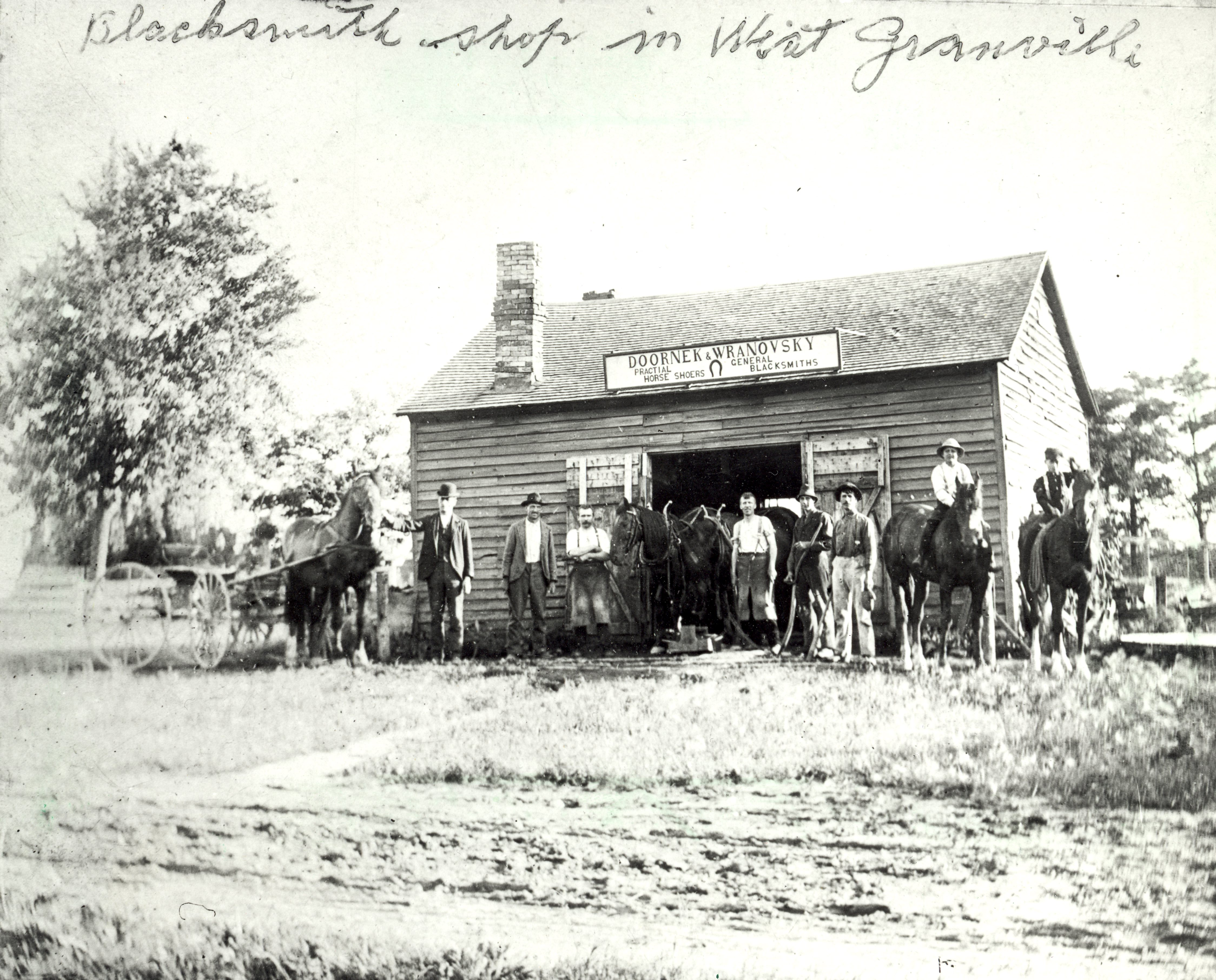 <table class=&quot;lightbox&quot;><tr><td colspan=2 class=&quot;lightbox-title&quot;>Granville Blacksmiths</td></tr><tr><td colspan=2 class=&quot;lightbox-caption&quot;>An 1898 photograph of the Doornek &amp; Wranovsky Blacksmith shop in Granville.</td></tr><tr><td colspan=2 class=&quot;lightbox-spacer&quot;></td></tr><tr class=&quot;lightbox-detail&quot;><td class=&quot;cell-title&quot;>Source: </td><td class=&quot;cell-value&quot;>From the Historic Photo Collection of the Milwaukee Public Library. Reprinted with permission.<br /><a href=&quot;http://content.mpl.org/cdm/singleitem/collection/HstoricPho/id/1306/rec/1&quot; target=&quot;_blank&quot;>Milwaukee Public Library</a></td></tr><tr class=&quot;filler-row&quot;><td colspan=2>&nbsp;</td></tr></table>