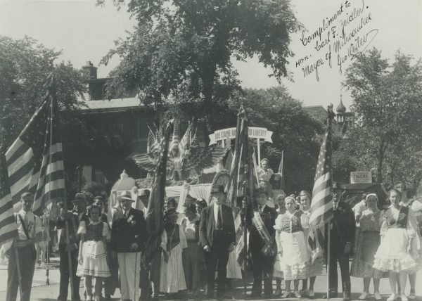 A group of of people from the U.S. American Hungarian Societies of Wisconsin stand in front of their float at the 1940 Midsummer Festival.