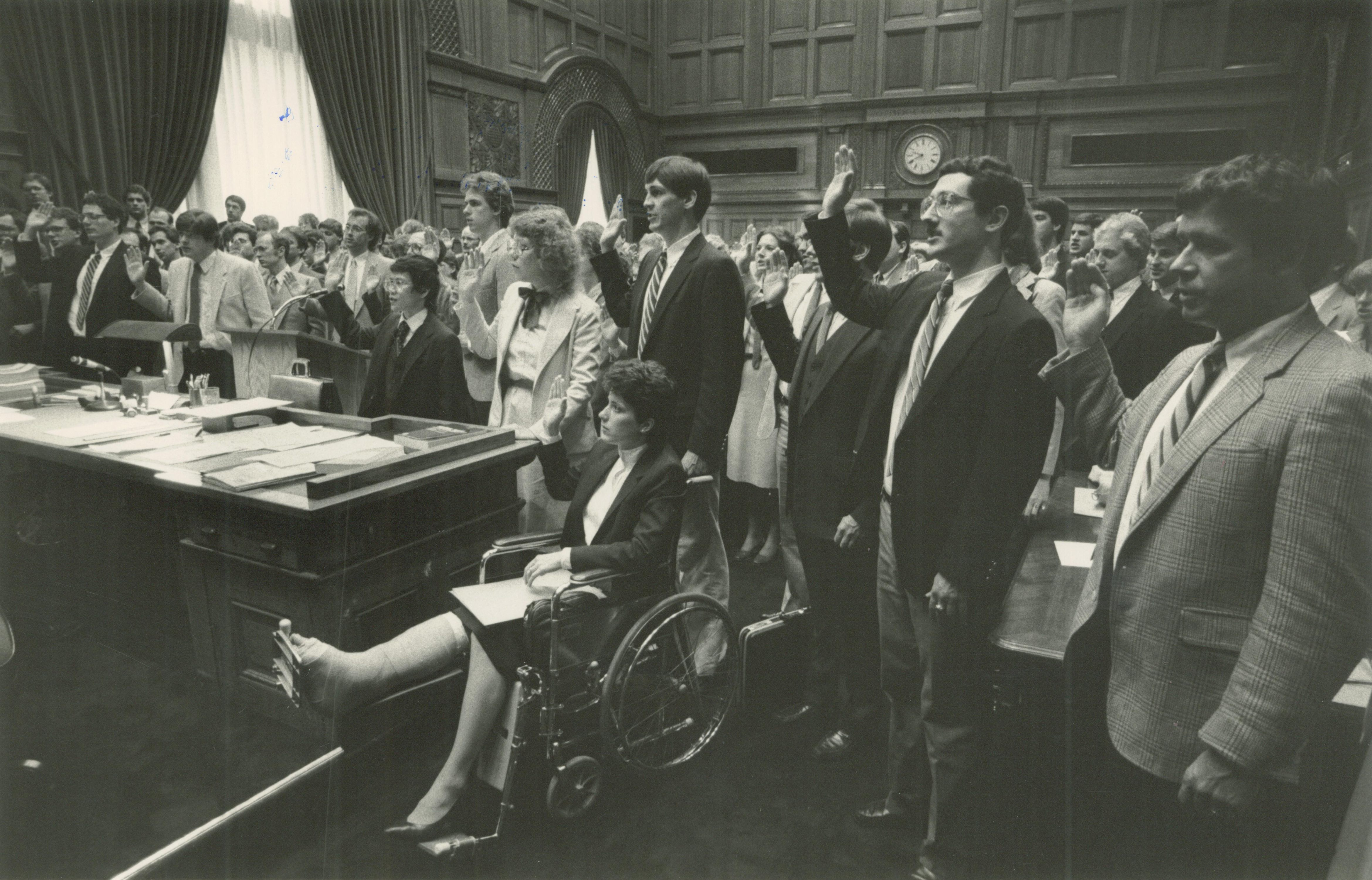 <table class=&quot;lightbox&quot;><tr><td colspan=2 class=&quot;lightbox-title&quot;>Lawyers Being Sworn In</td></tr><tr><td colspan=2 class=&quot;lightbox-caption&quot;>A group of Milwaukee lawyers are being sworn in in this photo from 1984.</td></tr><tr><td colspan=2 class=&quot;lightbox-spacer&quot;></td></tr><tr class=&quot;lightbox-detail&quot;><td class=&quot;cell-title&quot;>Source: </td><td class=&quot;cell-value&quot;>From the Historic Photo Collection of the Milwaukee Public Library. Reprinted with permission.<br /><a href=&quot;http://content.mpl.org/cdm/singleitem/collection/HstoricPho/id/4366/rec/1&quot; target=&quot;_blank&quot;>Milwaukee Public Library</a></td></tr><tr class=&quot;filler-row&quot;><td colspan=2>&nbsp;</td></tr></table>