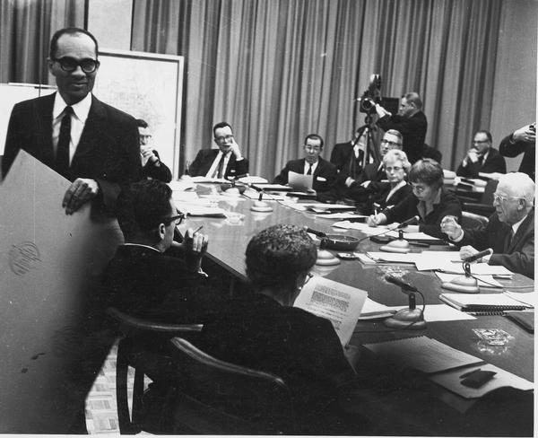 Lloyd Barbee walks out of this meeting of the Milwaukee Public School Board in 1964 after Chairman Harold W. Story refused to allow education representatives of civil rights groups, like Barbee, to participate.