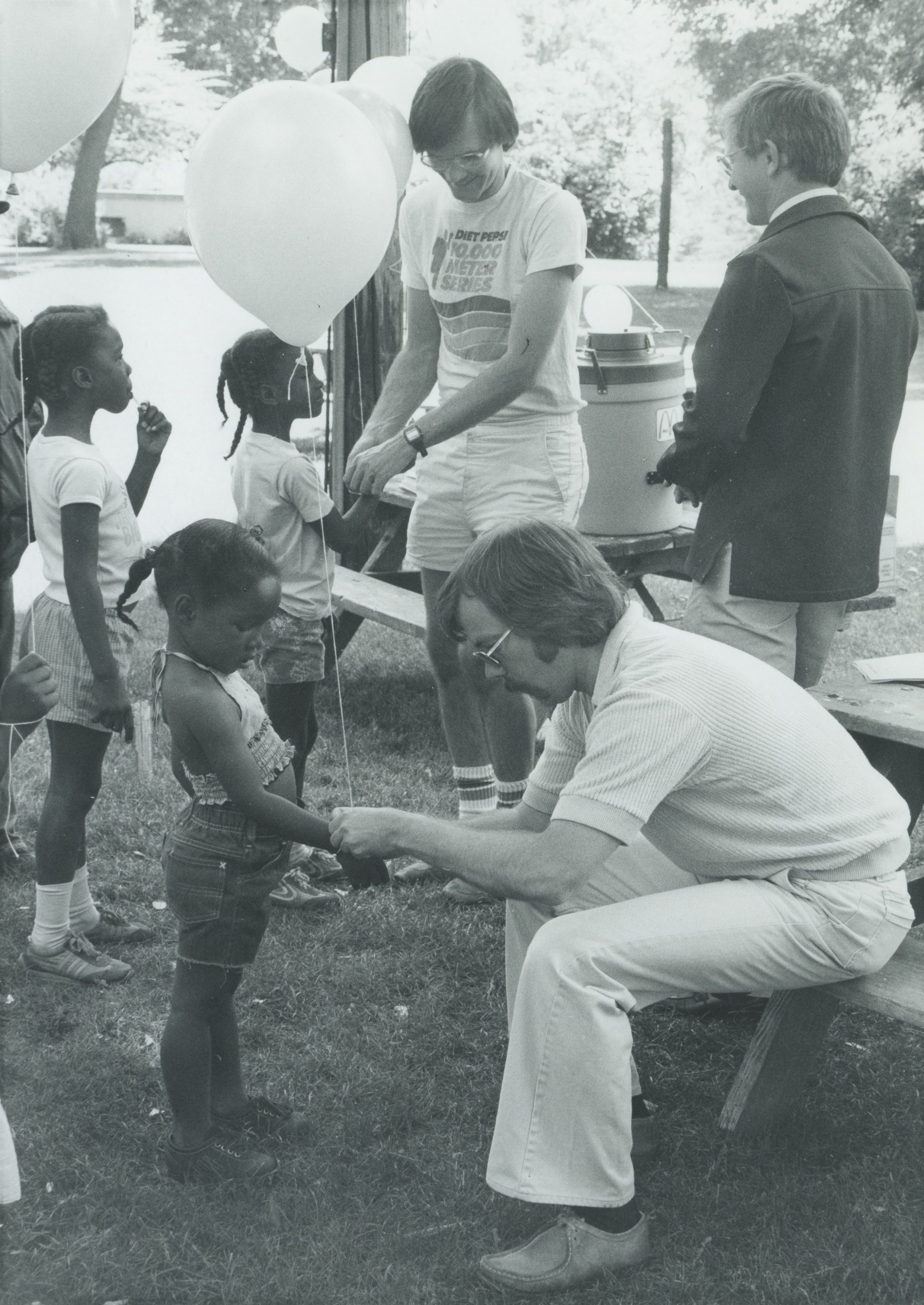Participants in a street festival run by the Midtown Neighborhood Association in May 1985.