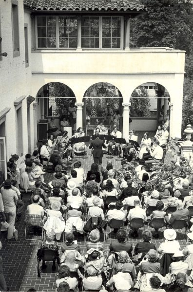 The Milwaukee Chamber Orchestra performs for an audience gathered on a Villa Terrace patio.