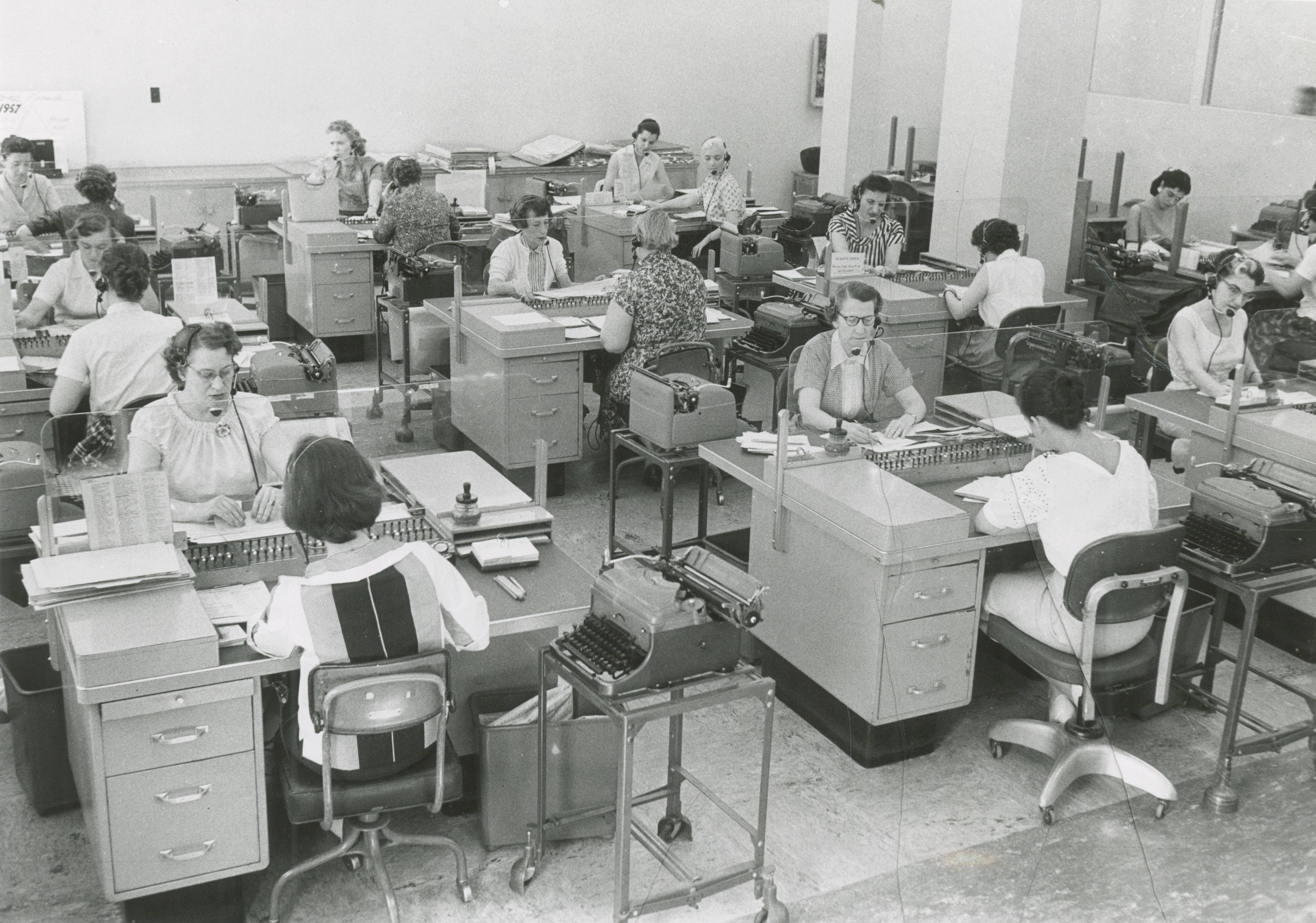 <table class=&quot;lightbox&quot;><tr><td colspan=2 class=&quot;lightbox-title&quot;>Milwaukee Journal Steno Pool</td></tr><tr><td colspan=2 class=&quot;lightbox-caption&quot;>A room full of women work at desks at the Milwaukee Journal. Each woman is wearing a headset, suggesting that this is the steno pool.</td></tr><tr><td colspan=2 class=&quot;lightbox-spacer&quot;></td></tr><tr class=&quot;lightbox-detail&quot;><td class=&quot;cell-title&quot;>Source: </td><td class=&quot;cell-value&quot;>From the Historic Photo Archive of the Milwaukee Public Library. Reprinted with permission.<br /><a href=&quot;http://content.mpl.org/cdm/singleitem/collection/HstoricPho/id/3491/rec/14&quot; target=&quot;_blank&quot;>Milwaukee Public Library</a></td></tr><tr class=&quot;filler-row&quot;><td colspan=2>&nbsp;</td></tr></table>