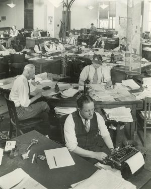 A room full of employees work at their desks on the fourth floor of the Milwaukee Journal building in 1943.