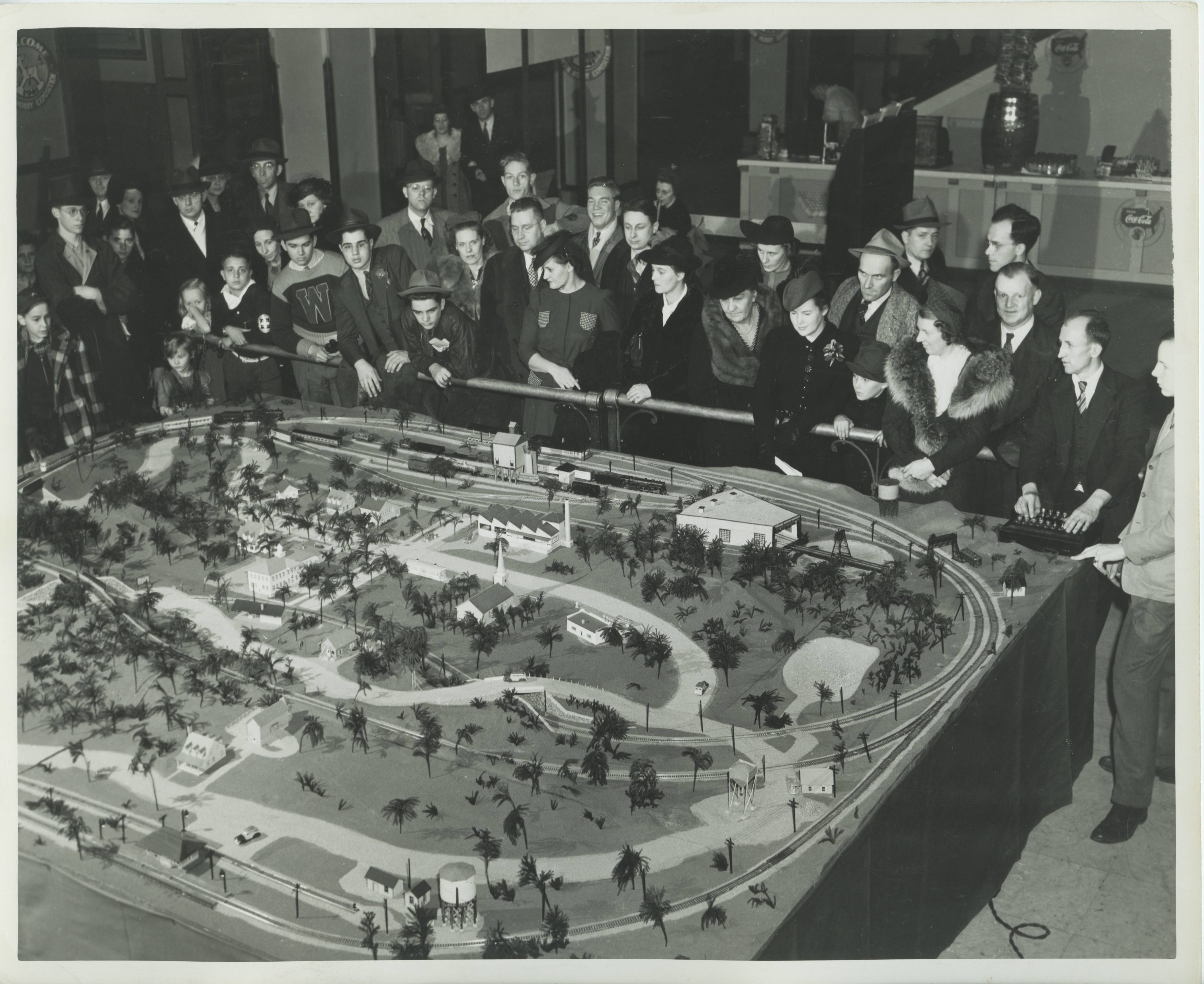 A crowd gathers around a large scale model railroad at the Wisconsin Hobby Exposition in Milwaukee in 1949.